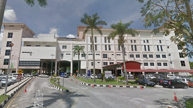 Malaysia man arrested for slapping doctor who refused to give wife MC