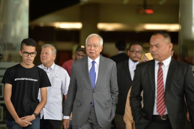 Najib's much-awaited trial begins today (April 3) at 2pm Read more at https://www.thestar.com.my/news/nation/2019/04/03/najibs-muchawaited-trial-begins-today-april-3-at-2pm/#zMjWSrtFurE09BFu.99