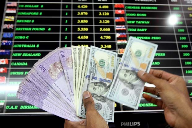Ringgit lifted against US$ by higher oil price