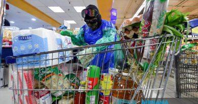 Man ventures out after 8 days of MCO in garbage bag 'hazmat suit'